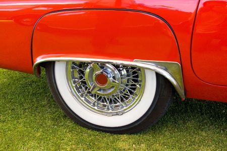 custom car: lateral red american vintage car, white wheel