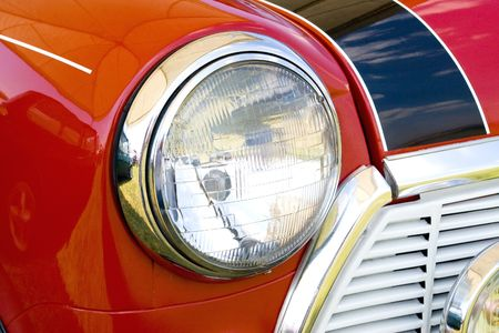 headlight in red england mini vintage car  Editorial