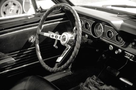 dasboard of vintage american seventies car in black and white
