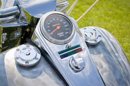 motorcycle crome dashboard with speedometer in orange photo