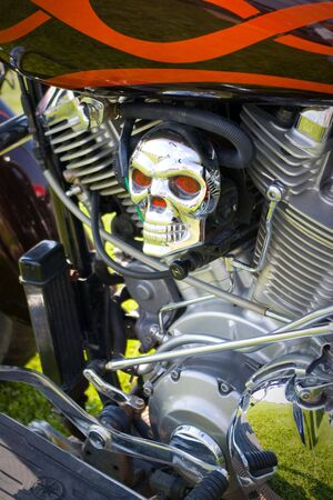 motorcycle skull with red eyes in close up photo