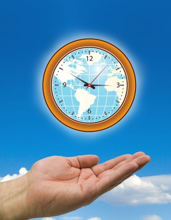 hand holding a wall clock with clouds photo