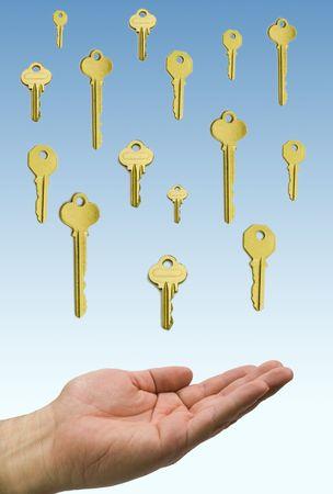 hand holding a rain of golden  keys photo