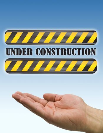 hand under construction sign blue photo