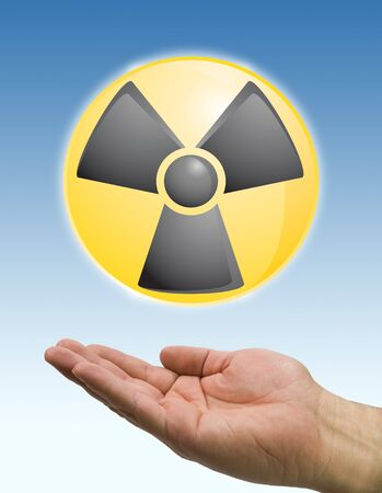 hand and radiation icon on blue sky photo