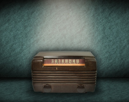 vintage radio on green background photo