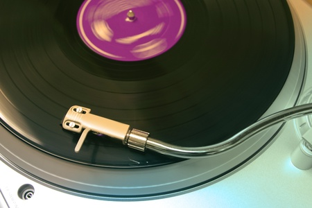 record albums: silver turntable and arm for music vinyl records