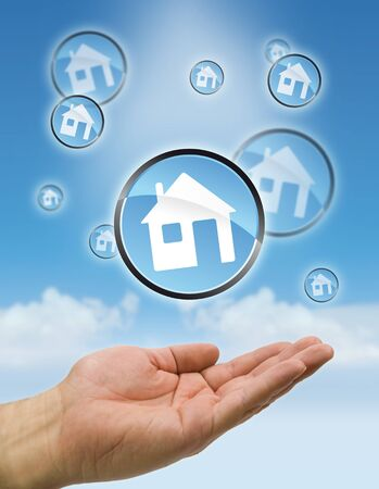 home purchase: hand with bubbles house flying Stock Photo
