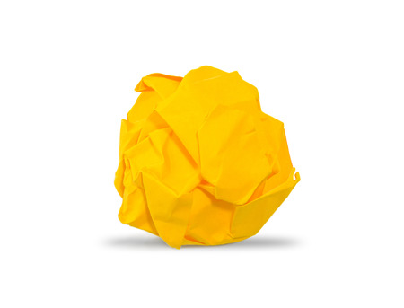 yellow paper: Yellow crumpled paper ball with shadows