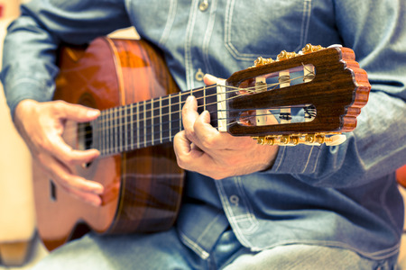 cool guy: Vintage guitar player in artistic performance Stock Photo