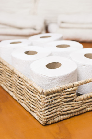 Toilet paper rolls on wicker basket