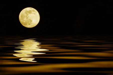 yellow moon over sea reflection
