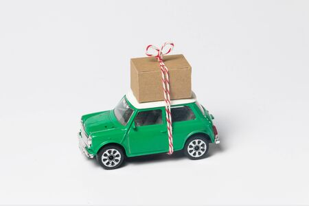 Green travel toy car, with box on top