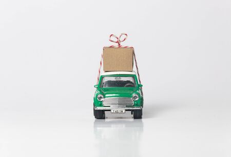 Green travel toy car side on white