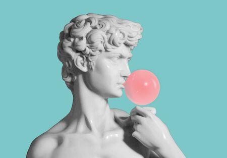 replica of david sculpture medium shot with bubble gum Stock Photo