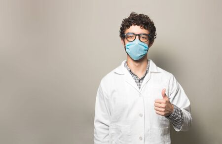 Doctor with tumb up wearing a face mask