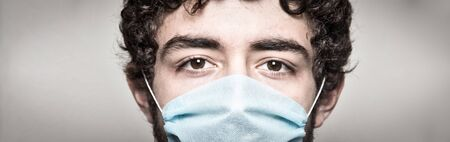 Doctor wearing protection face mask close up