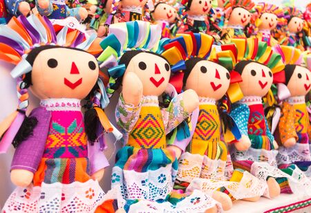 Colorful mexican dolls in market Mexico