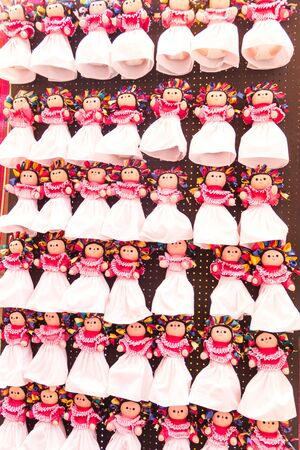 Mexican dolls in market wall Mexico 写真素材