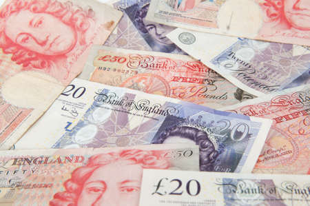 A stack of £20 and £50 Great British Pounds bank notes