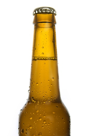 Cold frosted beer bottle on white background  photo