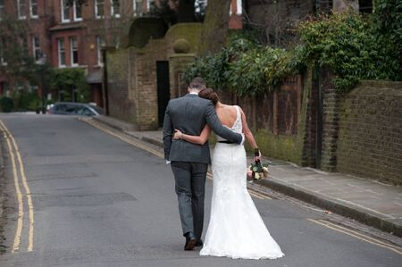 Bride and Groom walking away from the camera after their wedding  photo