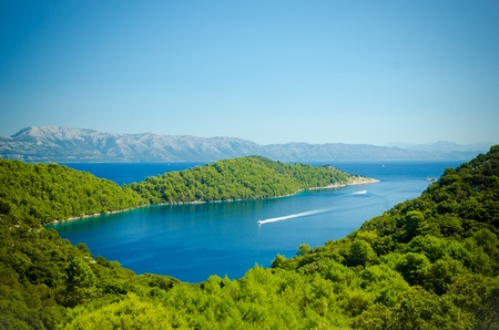 Landscape of the coast line of Mljet Croatia with the mountains in the background photo