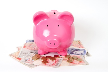 gbp: Pink Piggy bank with pound icons and GBP notes next to it