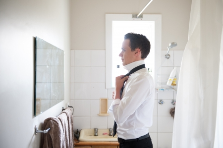 necktie: Best man getting ready for a special day.  Stock Photo