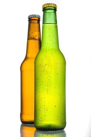 Close up of 2 Cold frosted beer bottles on white background  photo