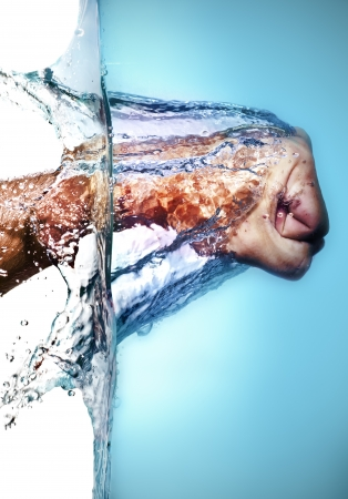 Isolated Caucasian Male Fist Hitting Blue Water and splashing drops on a white background  photo