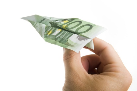Man Hand Holding 100 Euros Banknote Paper Plane isolated on White Background photo