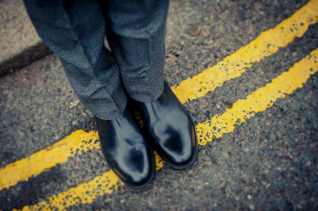 shinny: Londoner on immaculate shoes on a street road yellow line