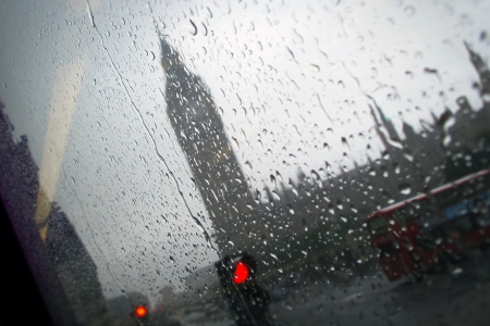 streets of london: Big Ben London under the Rain seen through the window of a Bus Stock Photo