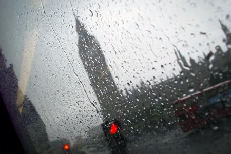 british weather: Big Ben London under the Rain seen through the window of a Bus Stock Photo