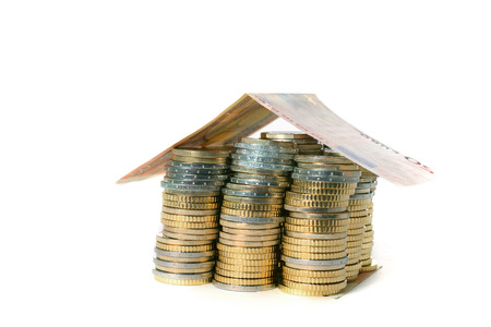 coins pile: Euro Coins pile House with banknote roof isolated on white  Stock Photo