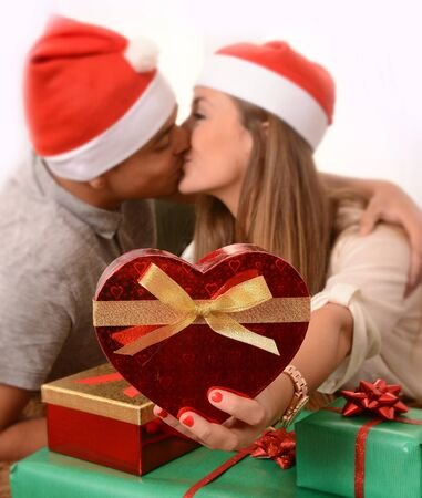 Romantic Young Happy Couple with Christmas Presents on rug at home photo