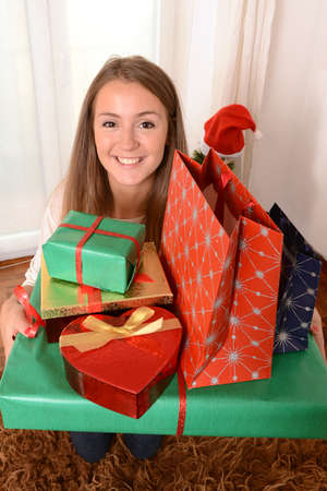 Young Beautiful Woman holding lots of Christmas Presents photo