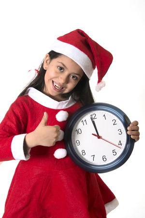 Little girl on Santa Claus costume holding Watch on Christmas photo