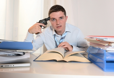 Student Overwhelmed and Stressed pointing Gun to his Head photo