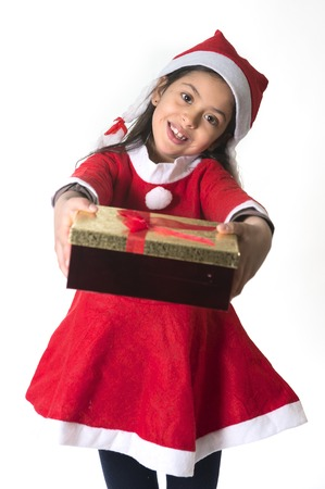 Cute Little Girl in Santa Claus costume holding a Christmas Box Present photo