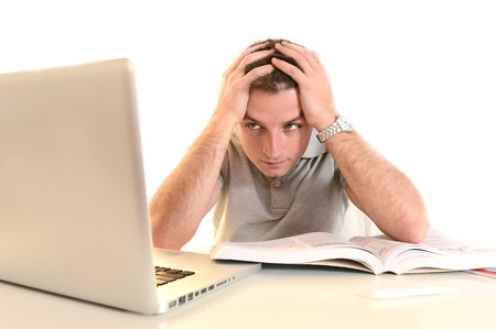 Overwhelmed Stressed and desperate Student  with Book and Laptop photo