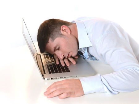 Stressed  Overworked Businessman sleeping over keyboard at Work  photo