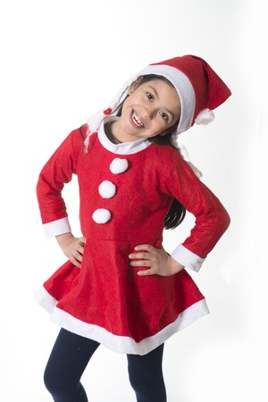 Cute Little Girl in Santa Claus costume standing happy at Christmas photo