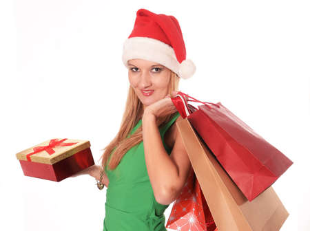 Young beautiful woman Christmas shopping bags and chic green dress photo
