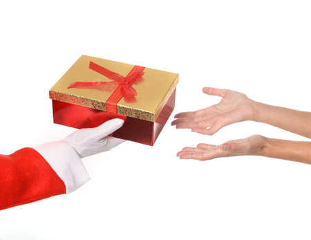 Santa Claus giving Christmas Present to Woman hands photo