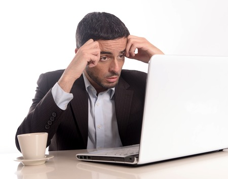 Business man with Computer overworked, stressed and desperate Stock Photo