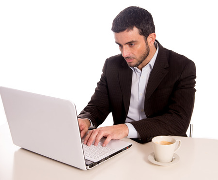 concentrating: horizontal portrait of a business man concentrating on a laptop on a white