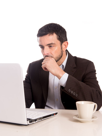 horizontal portrait of a business man concentrating on a laptop photo