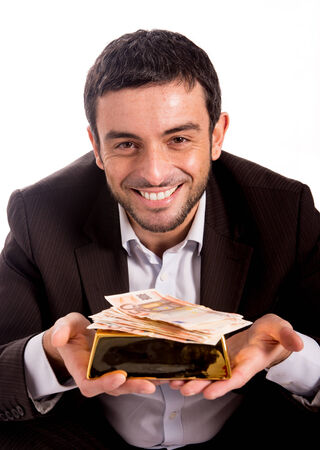 goldbar:  Happy Business man holding a goldbar and bank notes smiling at the camera